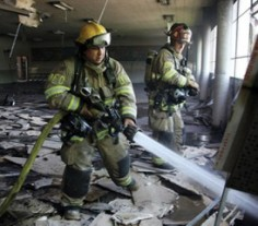 Firefighters inside a building