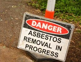 Danger sign, asbestos removal in progress