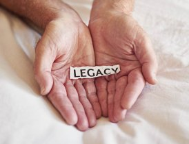 Hands holding a legacy note