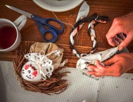 Woman making a cloth doll