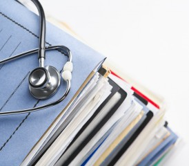 Stethoscope on top of medical files