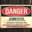 Red and black asbestos warning sign