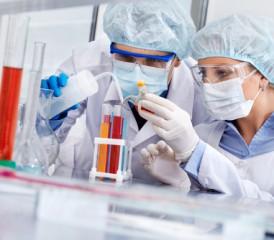 Researchers examining vials