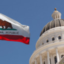 California state capitol with flag