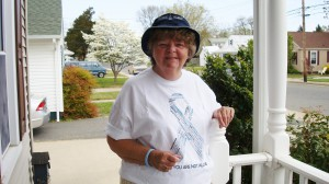 Mary Cook wearing Awareness shirt of Mesothelioma in Memory of my husband Harry Cook, sr. and Jr.