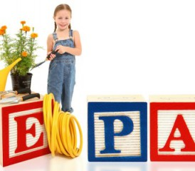 Child with large wooden blocks that spell EPA