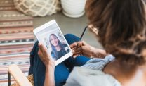Woman and teen visiting over FaceTime on tablet