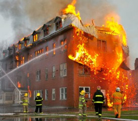 Firefighters extinguishing a building fire