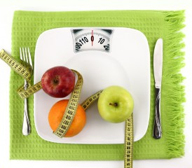 Scale with fruits, measuring tape and utensils