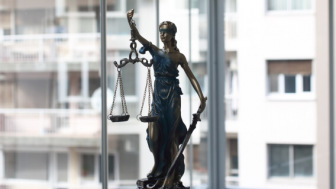Justice figure with scale