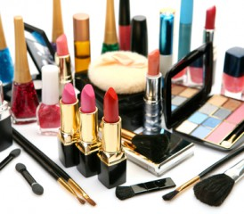 Collection of lipsticks, powders, brushes and other makeup tools