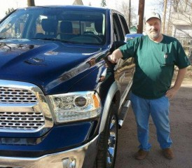 Mesothelioma Survivor Nick P. next to his blue truck