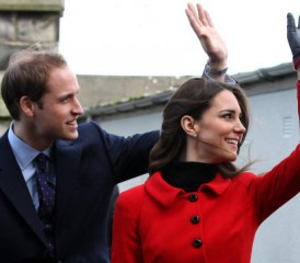 Prince William and Kate Middleton waving at crowd