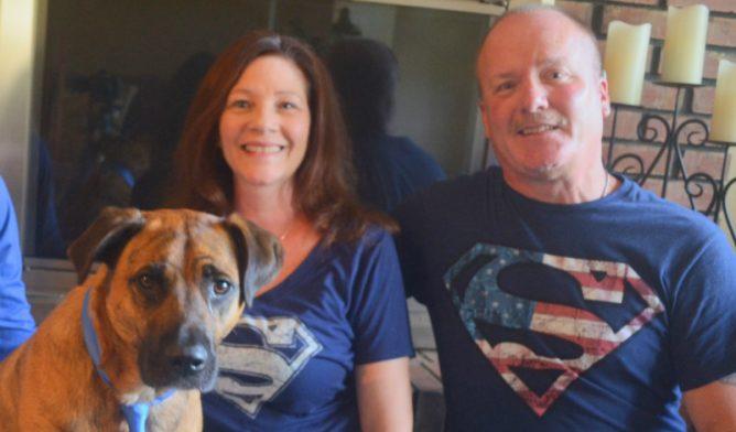 Ron Yutko, peritoneal mesothelioma survivor, with his wife and dog