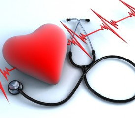 Red heart with stethoscope and EKG in background