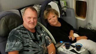 Mesothelioma survivor Doug Jackson and wife Cindy on plane