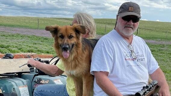 Pleural mesothelioma survivor Doug Jackson and his dog outdoors