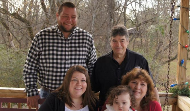 Mesothelioma survivor Tammy Frank (bottom right) and family