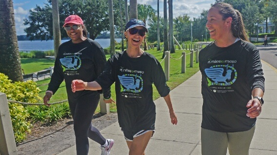 Women walking outdoors during Miles for Meso