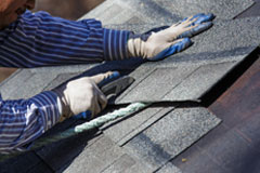 Man working on roofing shingles