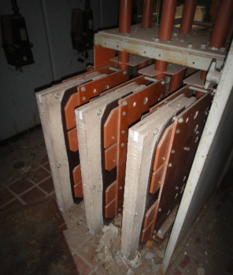 Asbestos barriers in electrical panel