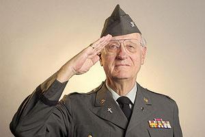 Older veteran of the U.S. Army saluting