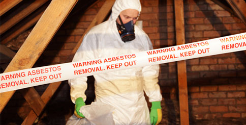 Asbestos removal professional in protective suit