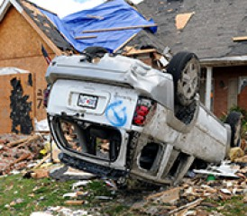 Upside down car after tornado