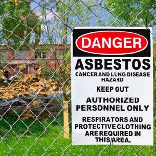 Asbestos warning outside of an abatement