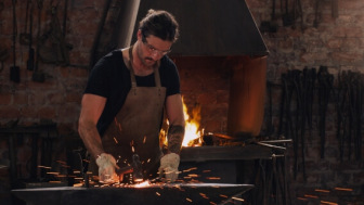 Blacksmith working with hot metal