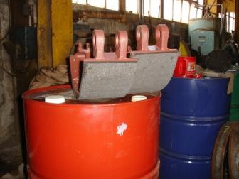 Large asbestos brake pads in steel mill