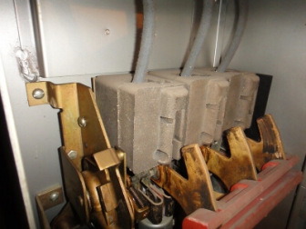Asbestos cement electrical arc chutes