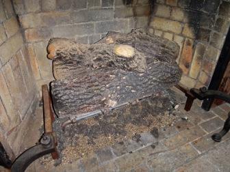 Asbestos logs in fireplace
