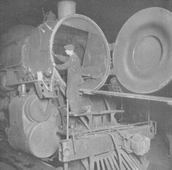 Railroad worker placing asbestos tape on train