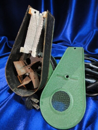 Asbestos insulation shown inside a vintage hair dryer