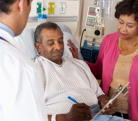 Black patient with wife at a hospital