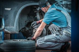 Mechanic looking at brakes