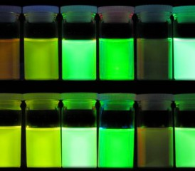 Glowing green cancer dyes in bottles