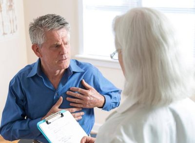 Cancer patient speaking to doctor about chest pain