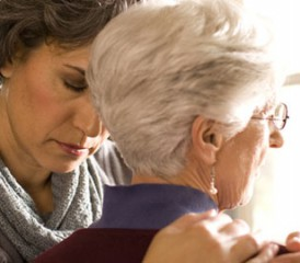 Woman Providing Comfort to Caregiver