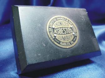 Ebonized asbestos lumber with Ambler logo