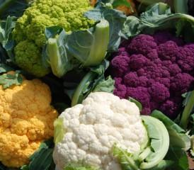 Different varieties of cauliflower, including white, purple, orange and yellow.