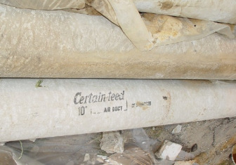 Pipes with covering labeled Certain-teed