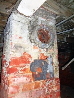 Brick chimney with asbestos cement