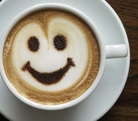 Cup of Coffee with a Happy Face in the Foam
