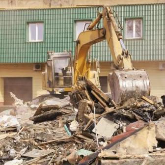 Backhoe clearing asbestos debris