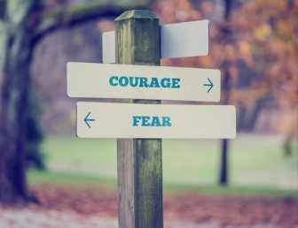 Signpost with courage and fear