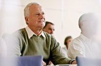 Older man listening in a support group