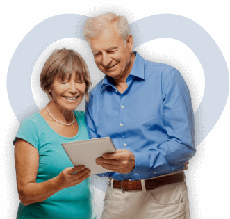 Elderly couple signing up for an online support group