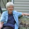 Mesothelioma survivor Emily Ward sitting on a bench